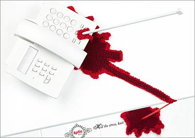 Ad for katia yarn, featuring a telephone that has been stabbed by knitting needles and is dripping blood. The 'blood' is actually knitted yarn.
